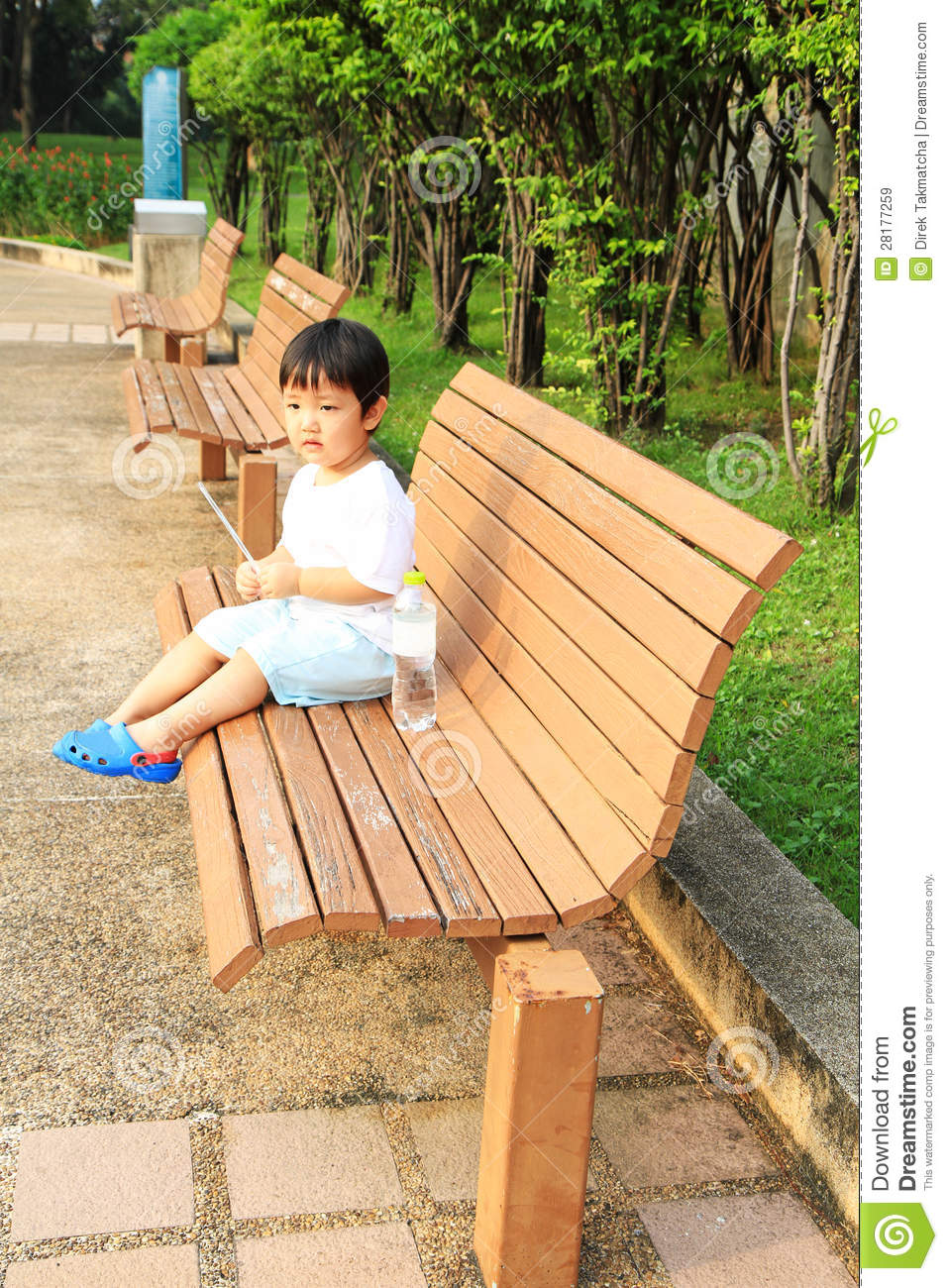 Asian Boy Sitting On The Bench Royalty Free Stock Images - Image ...