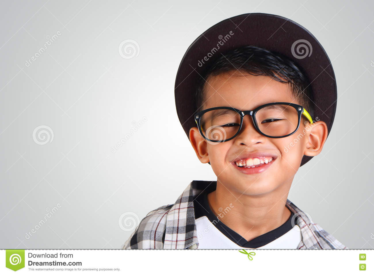 a01d159d1e5f Portrait of cute happy young Asian boy wearing hat and glasses smiling