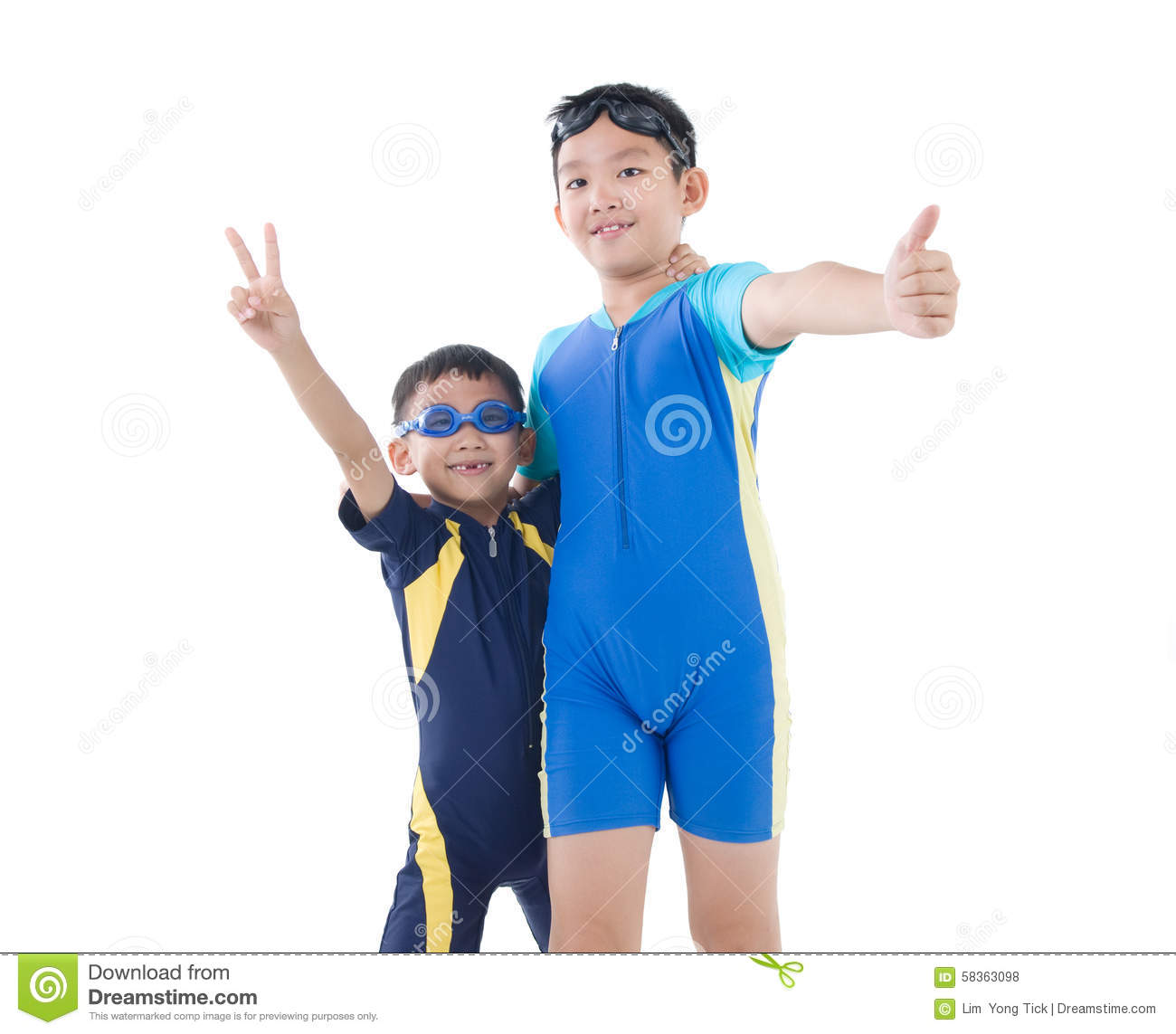 Young asian boys in swimsuit and swim goggles on isolated white backdround.