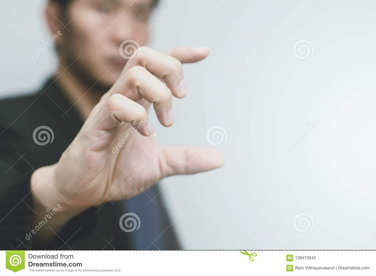 Asian business man with hand finger show size or scale