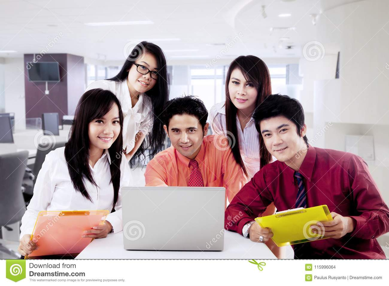 Asian business team with laptop
