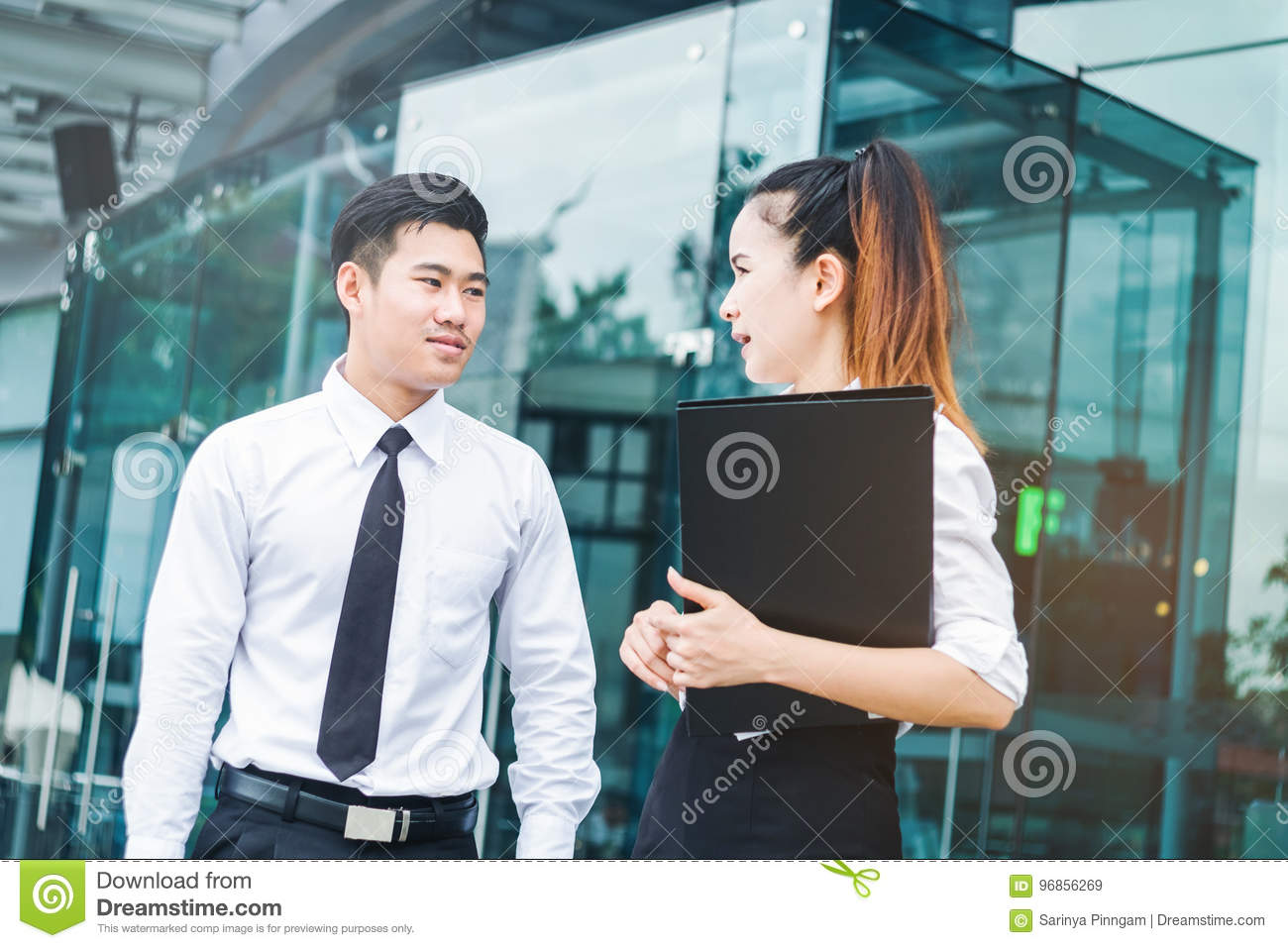 Asian Business people talking outside office after work