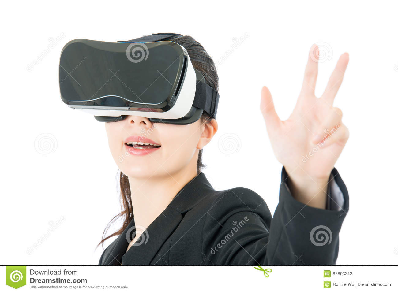 Woman Using VR Device. Young Woman Using A Virtual Reality