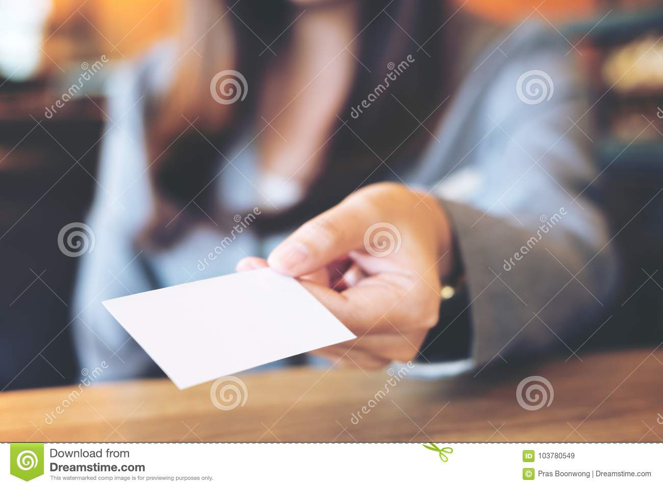 Asian Business Woman Holding And Giving Empty Business Card In ...