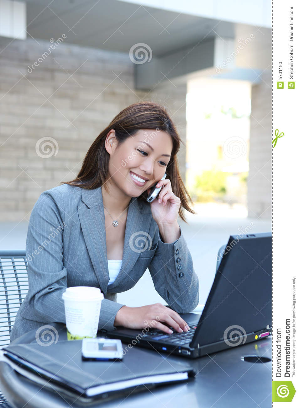 Asian Business Woman on Laptop