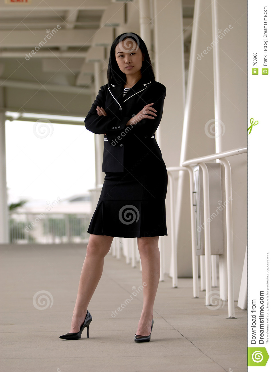 Asian Business Woman Standing With Arms Folded Looking -3147