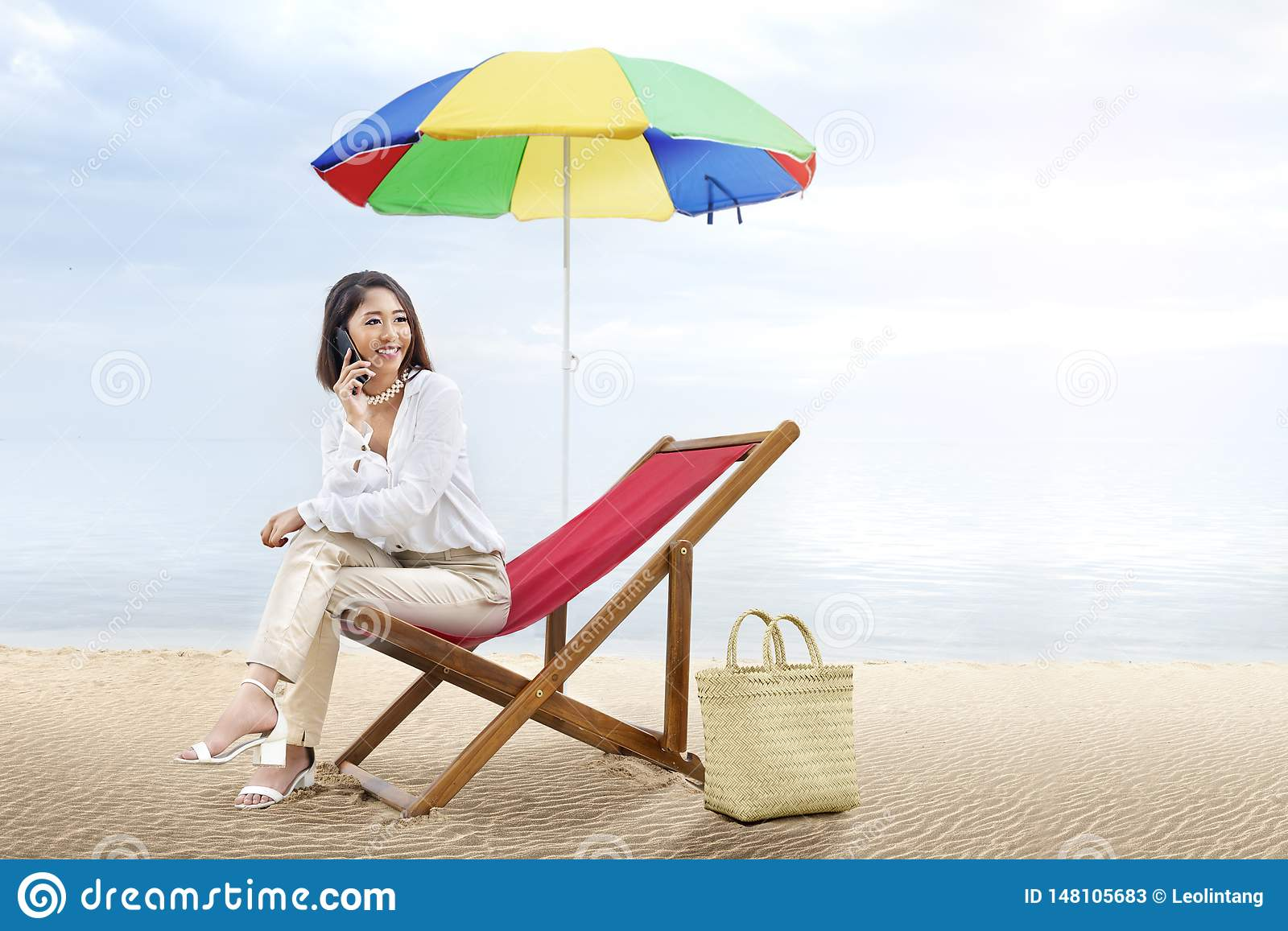147 Person Sitting Beach Chair Umbrella Photos Free Royalty Free Stock Photos From Dreamstime
