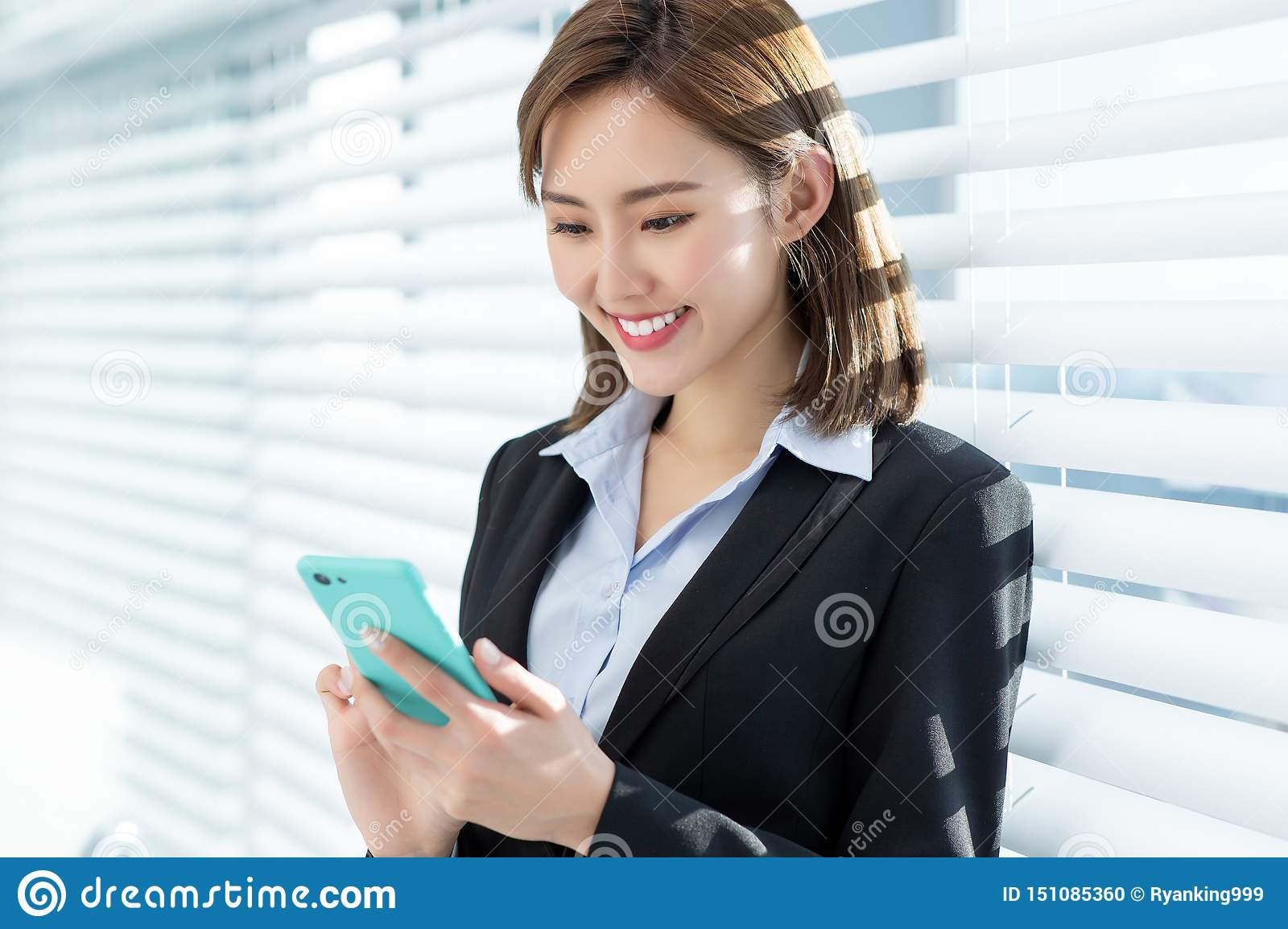 Asian business woman use phone