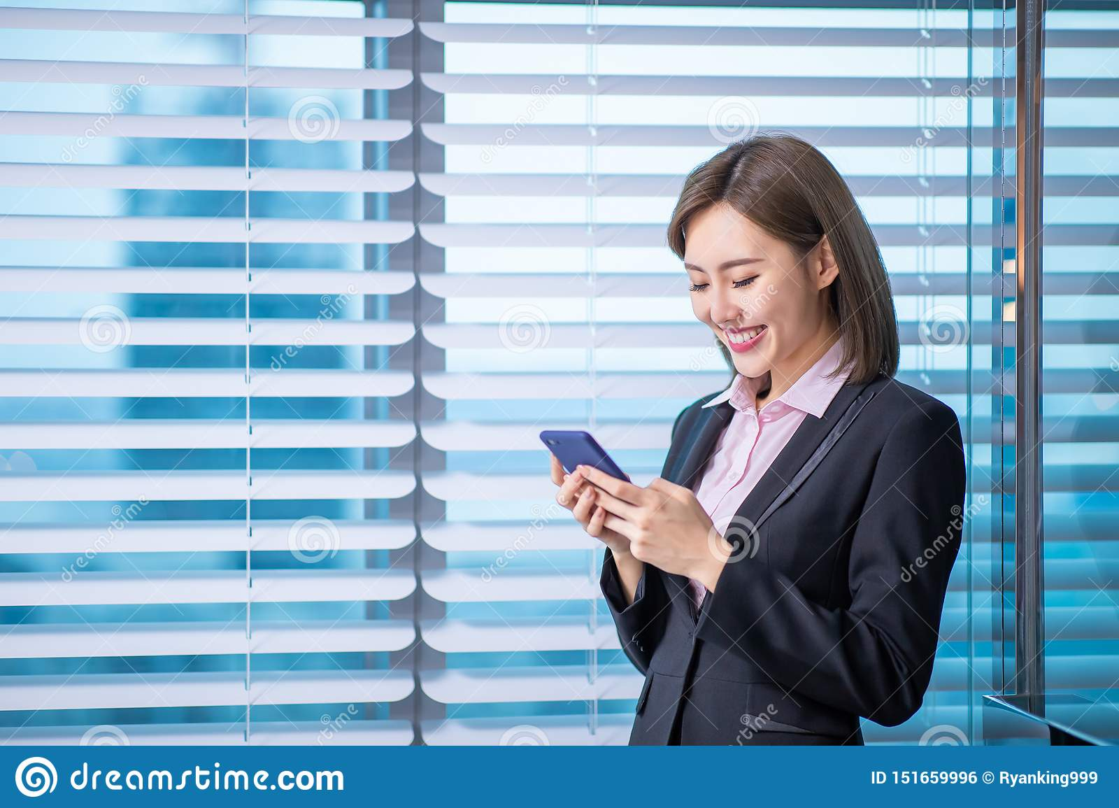 Asian business woman use smartphone