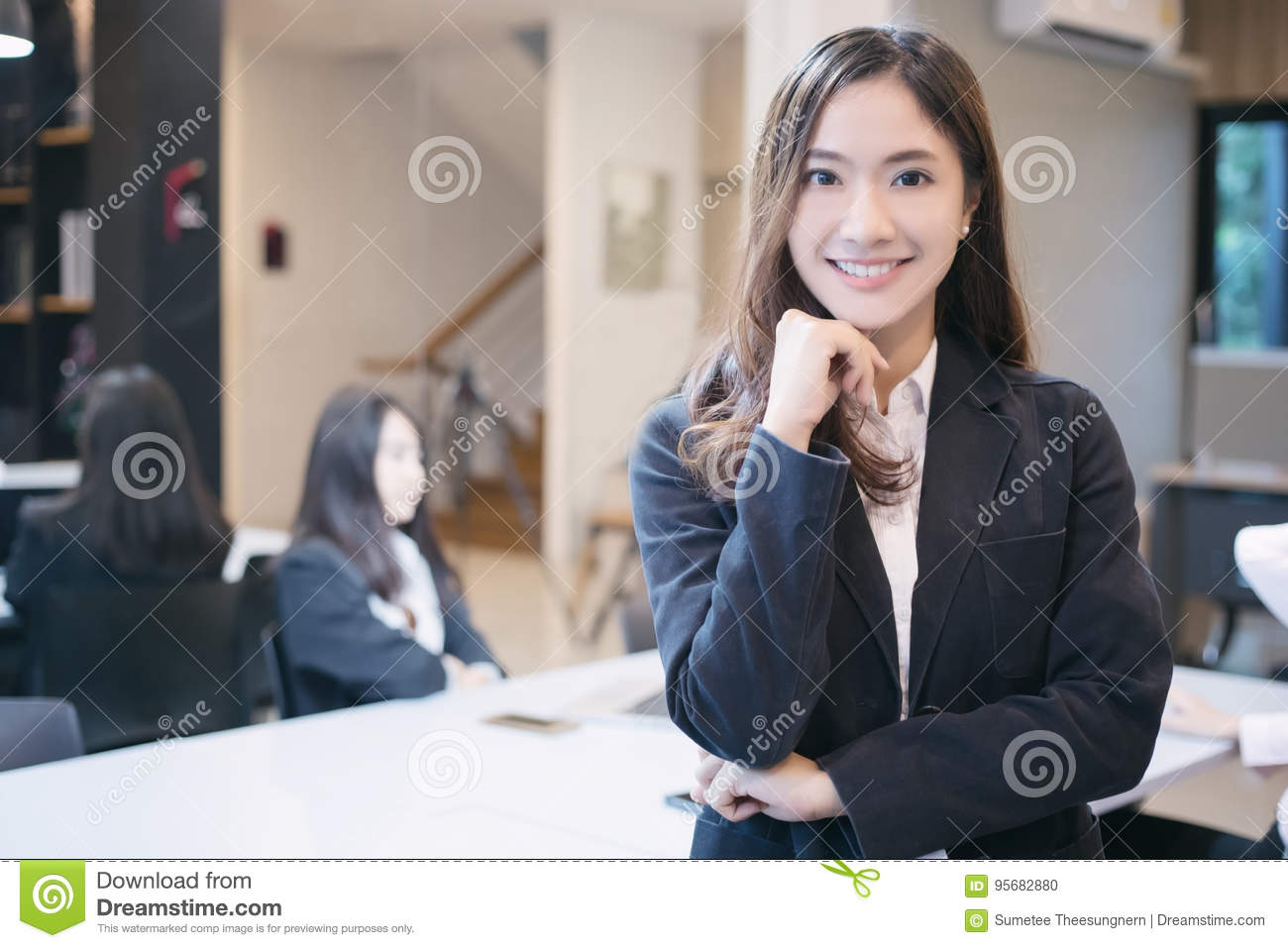 Asian business women and group using notebook for meeting and bu