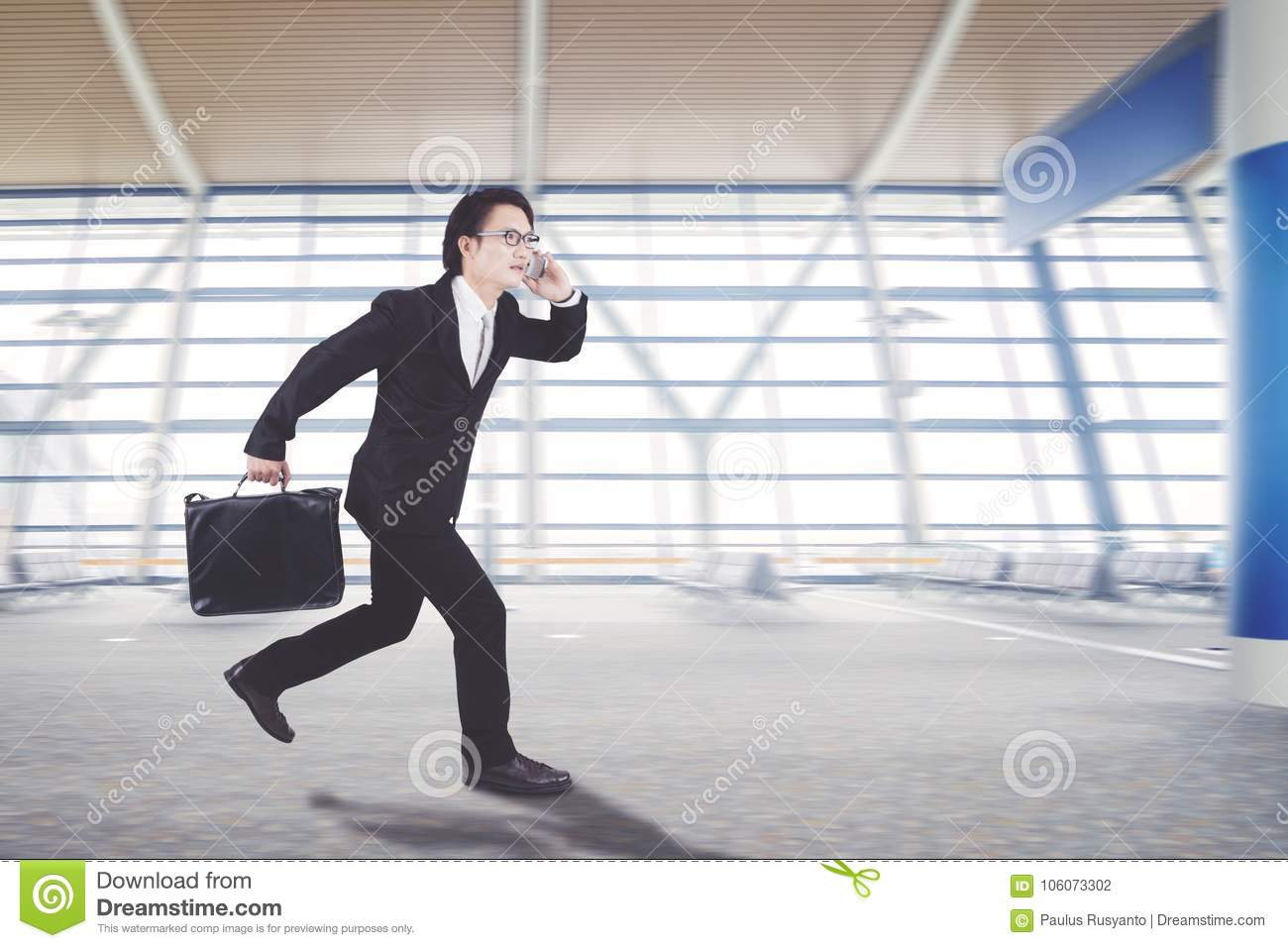 Asian businessman is running in the arrival hall