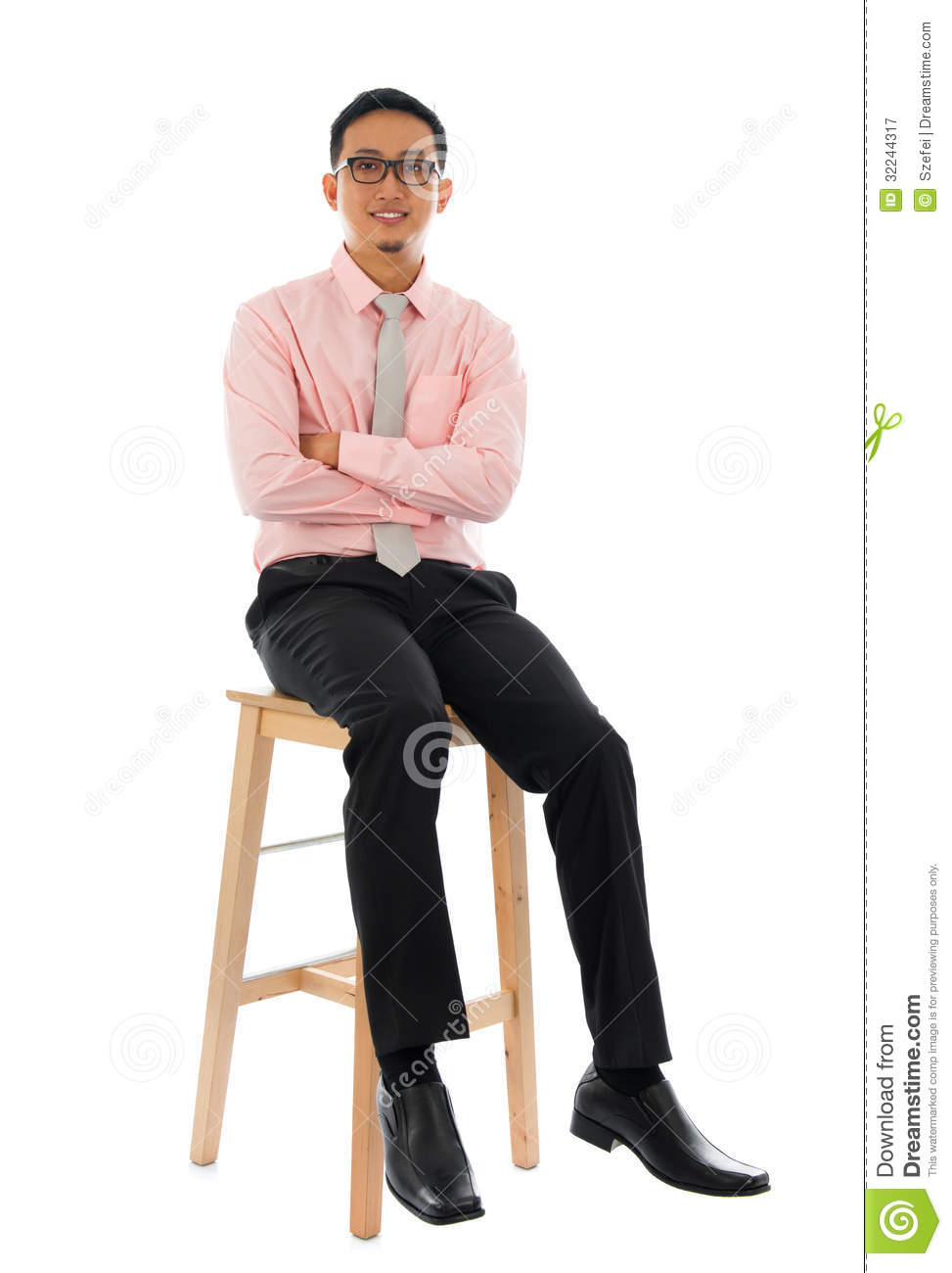 Asian businessman sitting on a wooden chair royalty free for Sitting chairs
