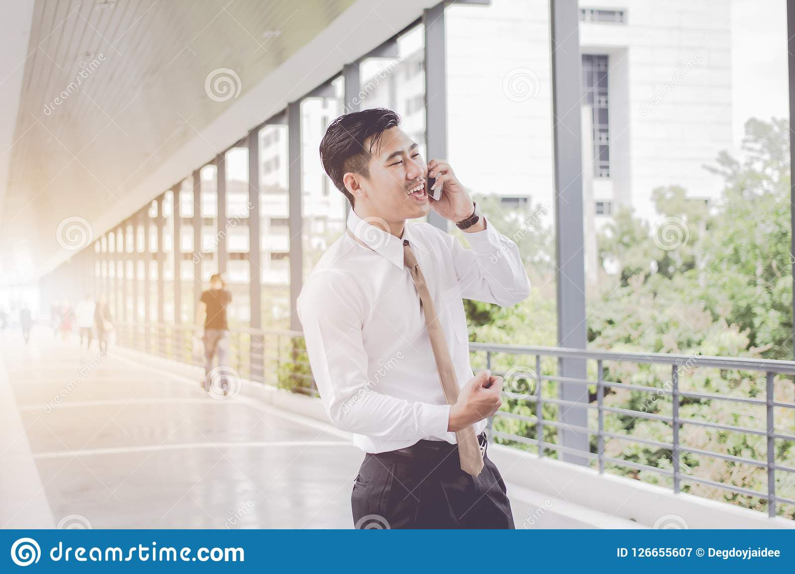 Asian Businessman are smiling call phone talking and relax, Meetings between executives. between waiting on On sidewalks.