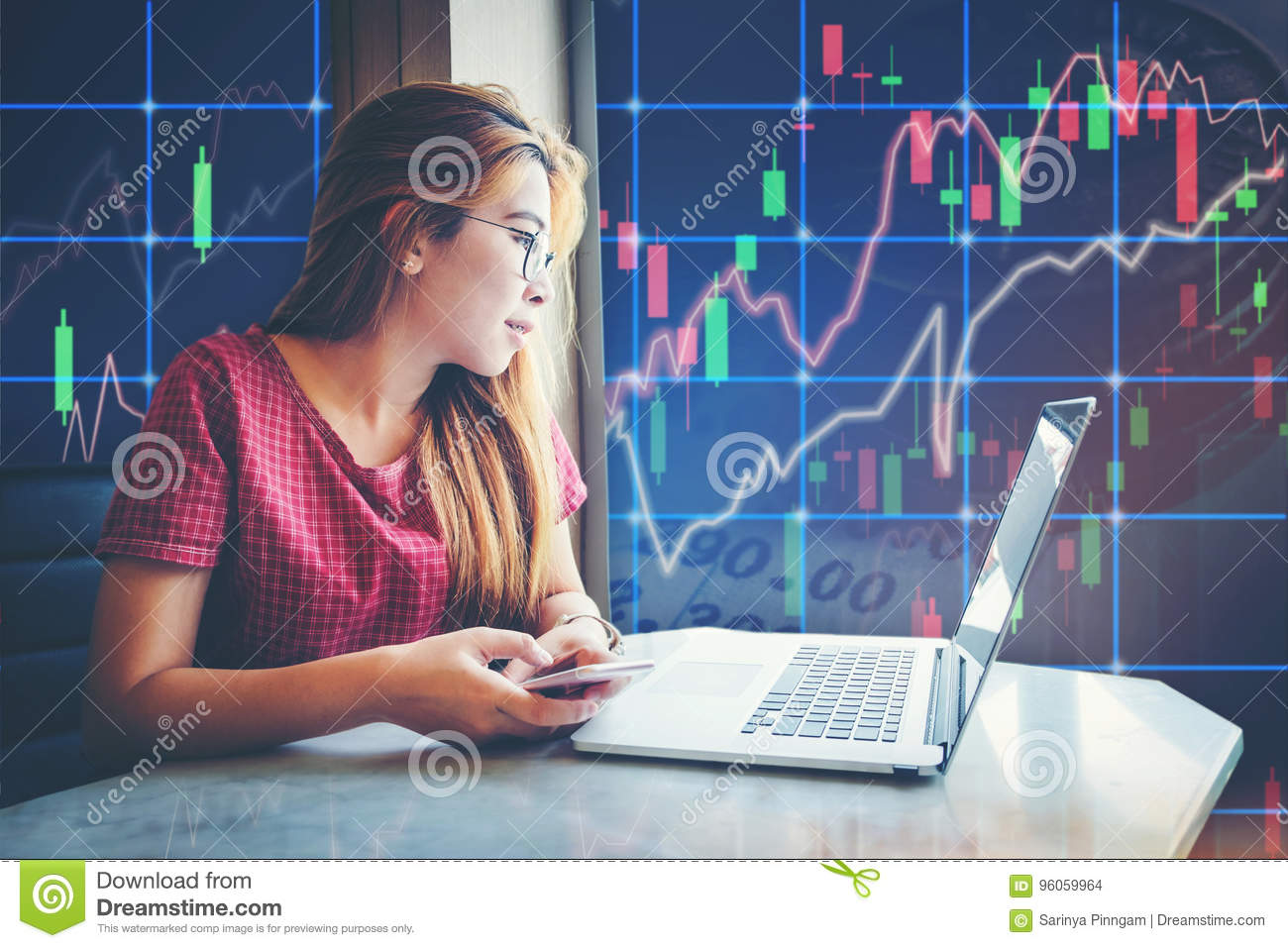 asian businesswoman sitting amd working Laptop Stock market exchange information and Trading graph