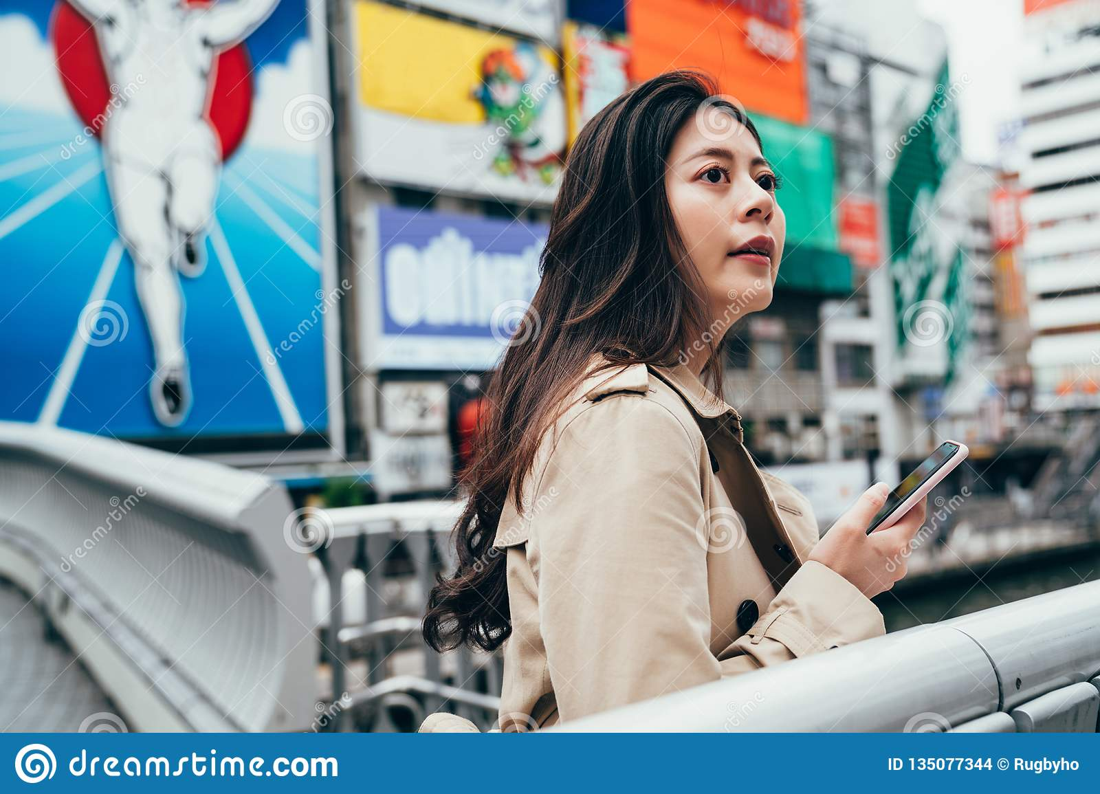 Asian businesswoman using phone find directions