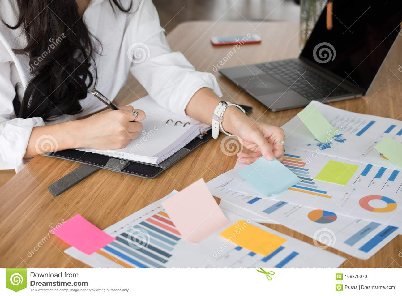 Businesswoman write note on notebook at workplace. startup woman
