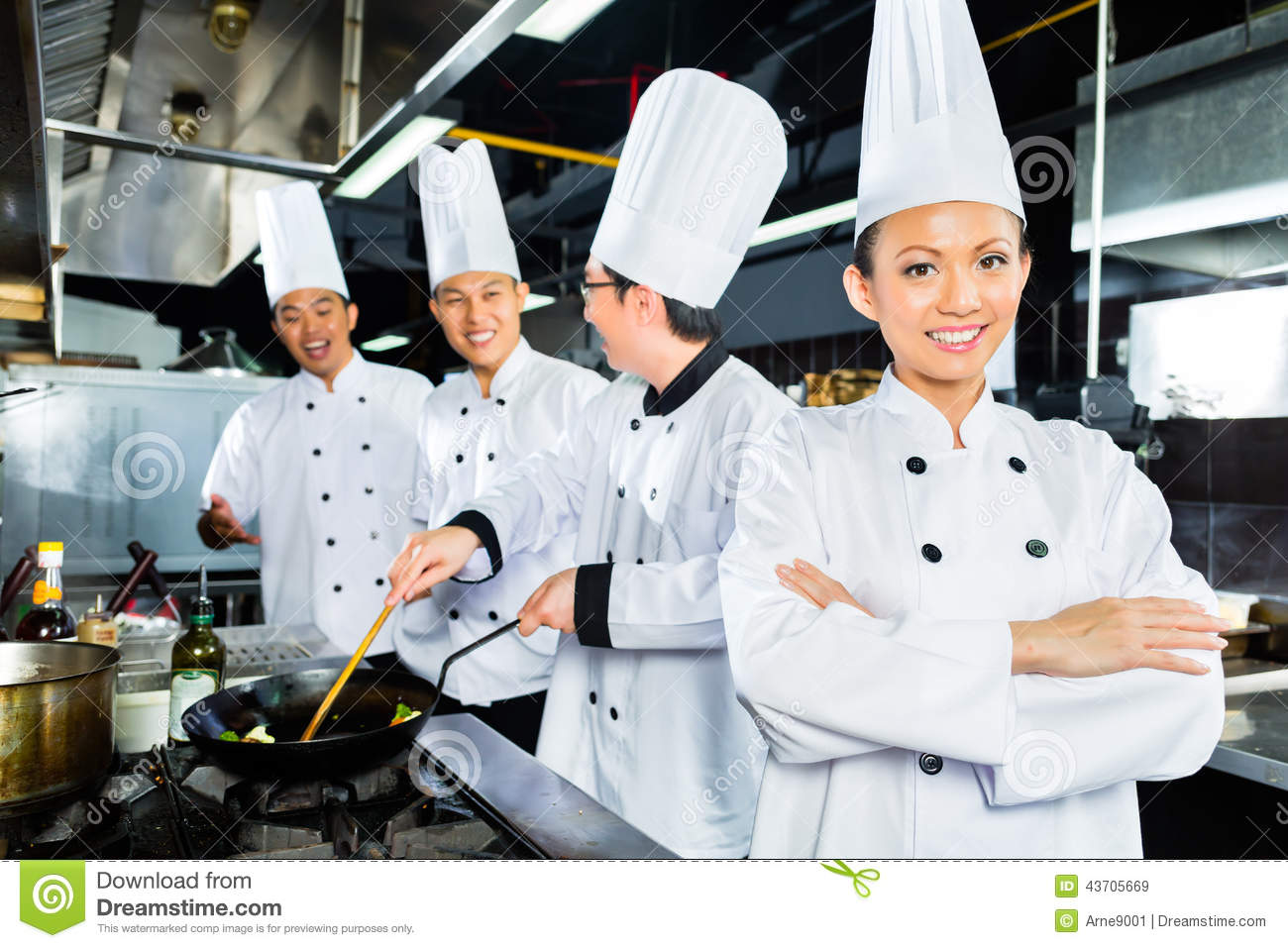 indonesian chefs along with other cooks in restaurant or hotel kitchen