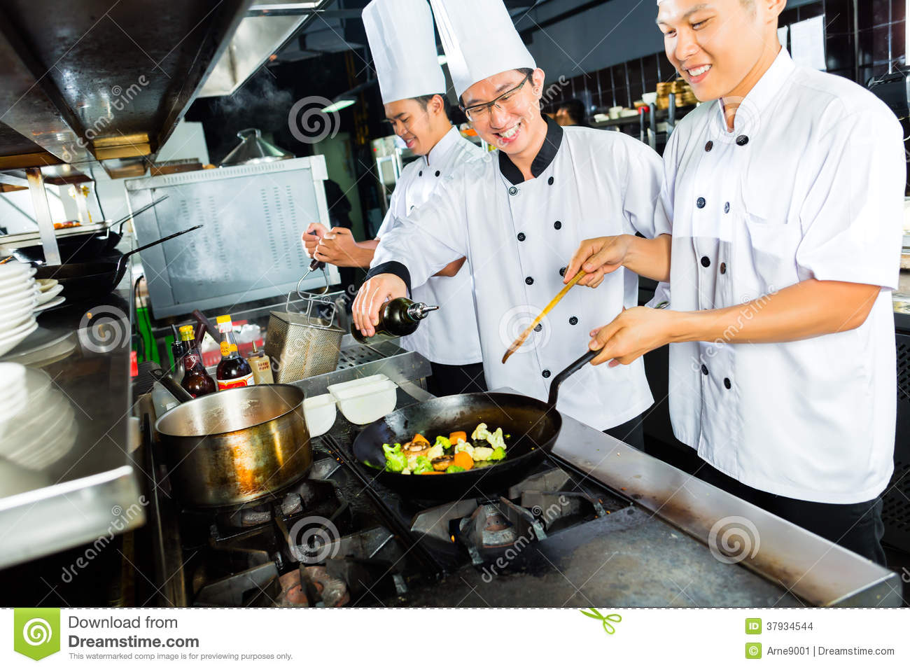 Restaurant Kitchen Chefs asian chefs in restaurant kitchen cooking stock images - image