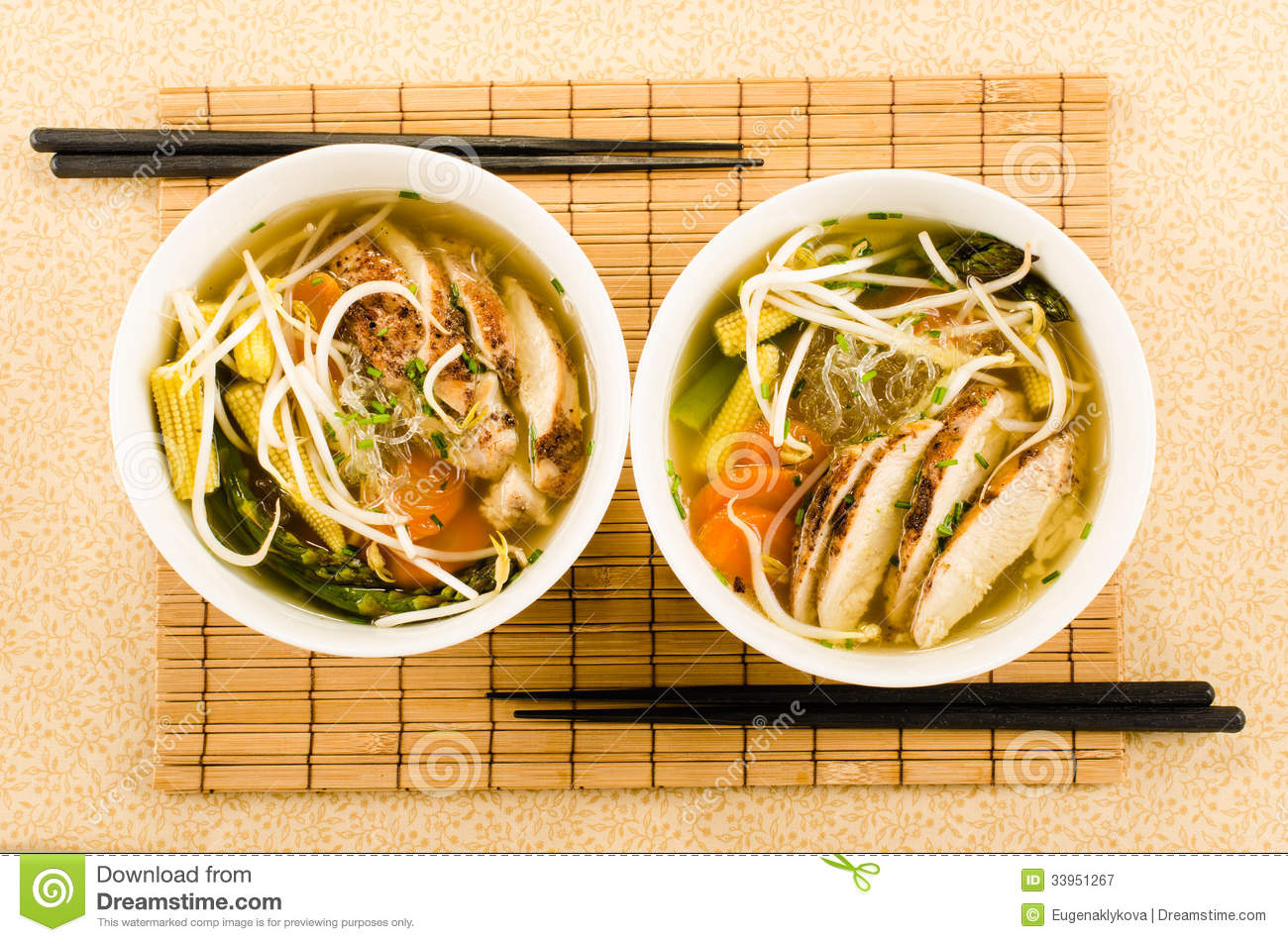 Asian chicken noodle soup with glass noodles, beam sprouts and v