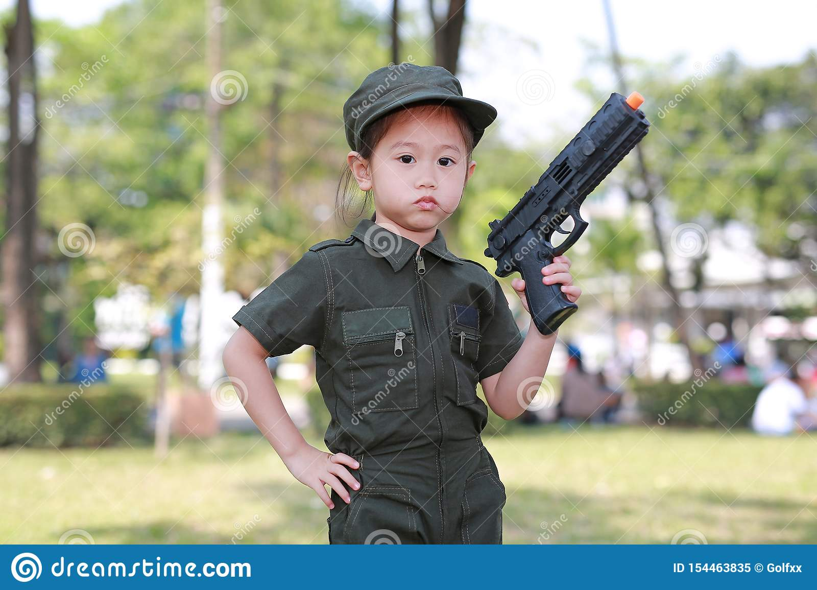 Asian Child Girl In Pilot Soldier Suit Costume With Shooting