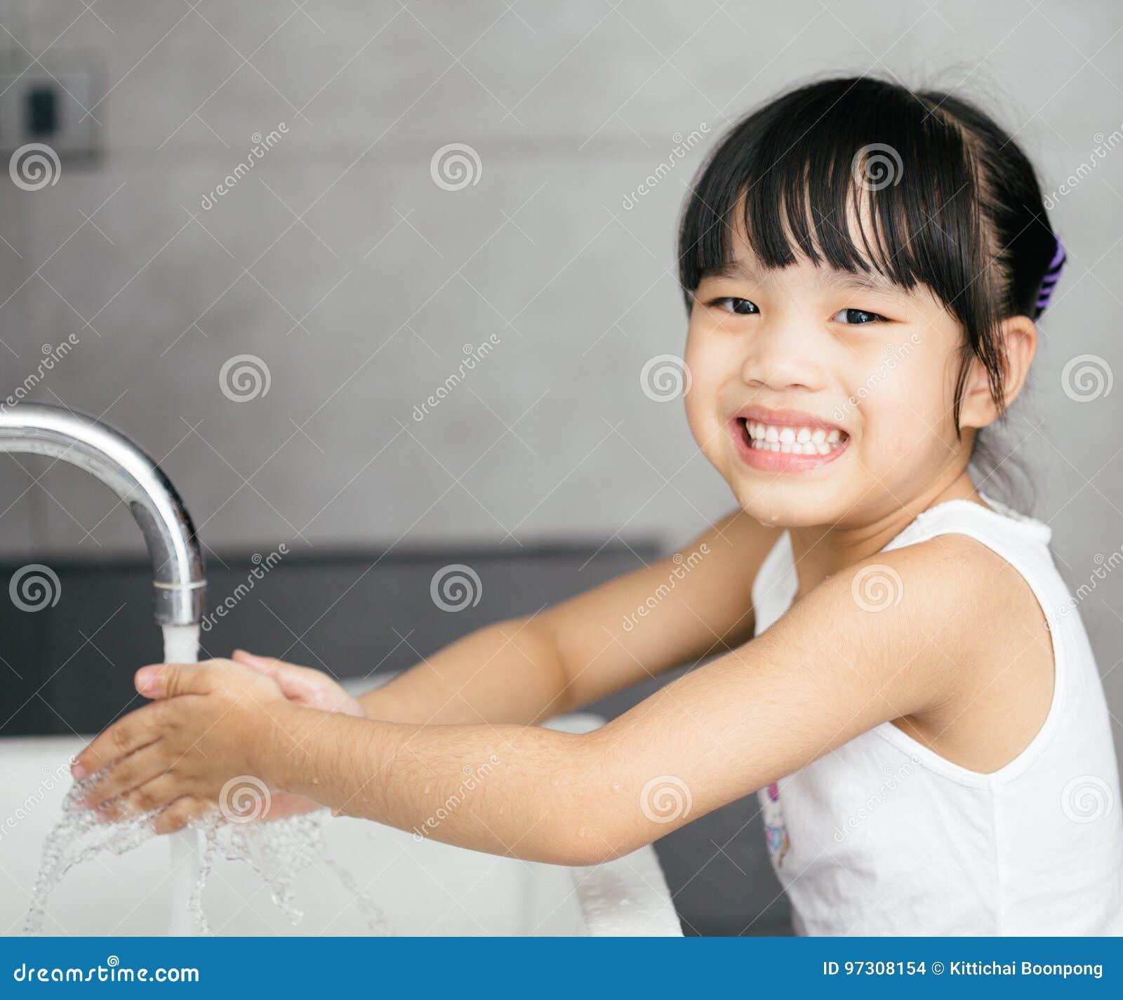 Asian Child Washing Hands