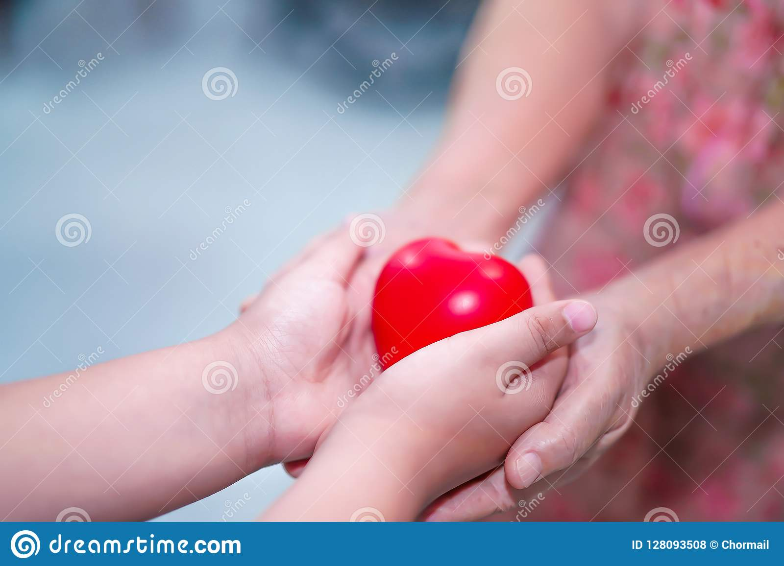 Asian children kid hold touch and give red heart strong health to old mother lady hands with love, happy, care.