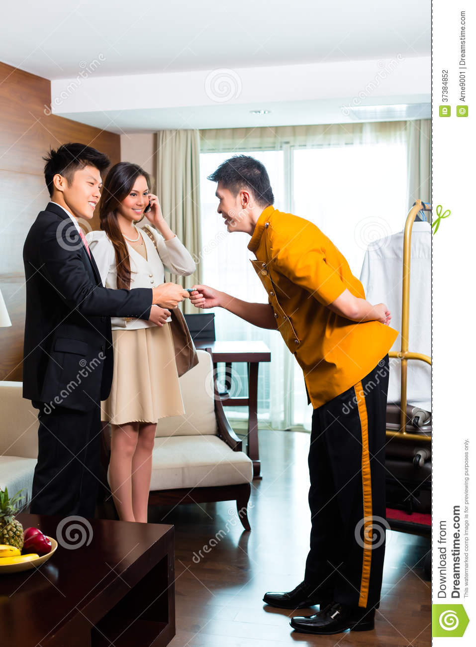 Asian Chinese Bell Boy Or Porter Receiving Tip Stock Photo