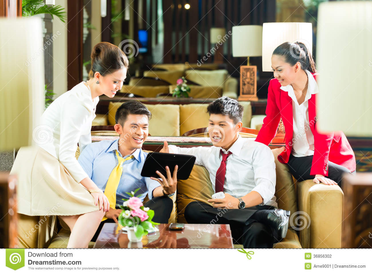 Asian chinese business people meeting in hotel lobby stock for Luxury hotel group