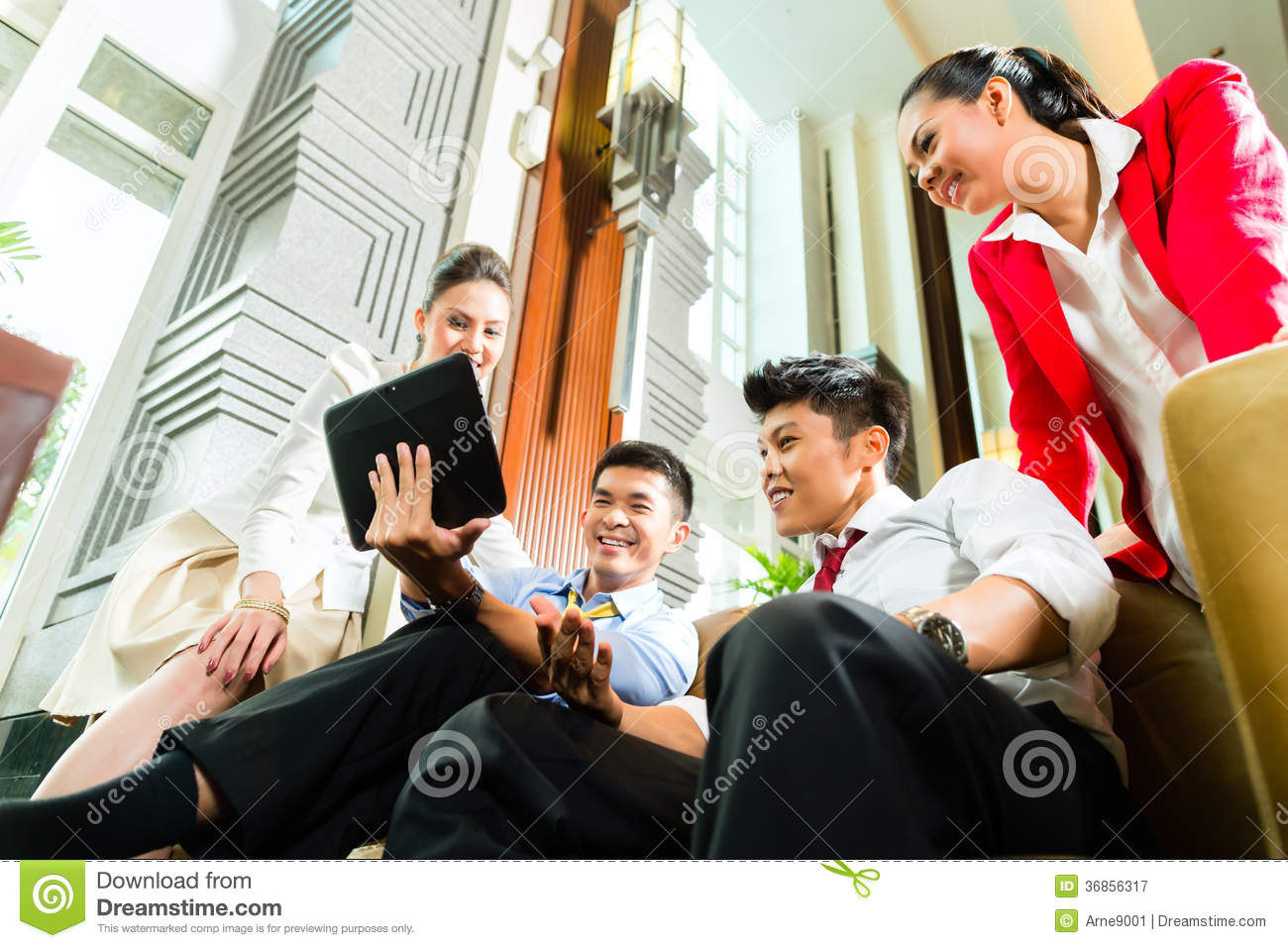 Asian chinese business people meeting in hotel lobby for Small hotel groups