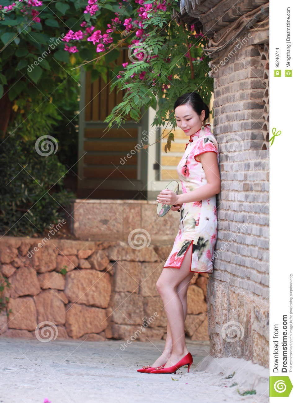 Asian Chinese girls wears cheongsam enjoy free time in ancient town