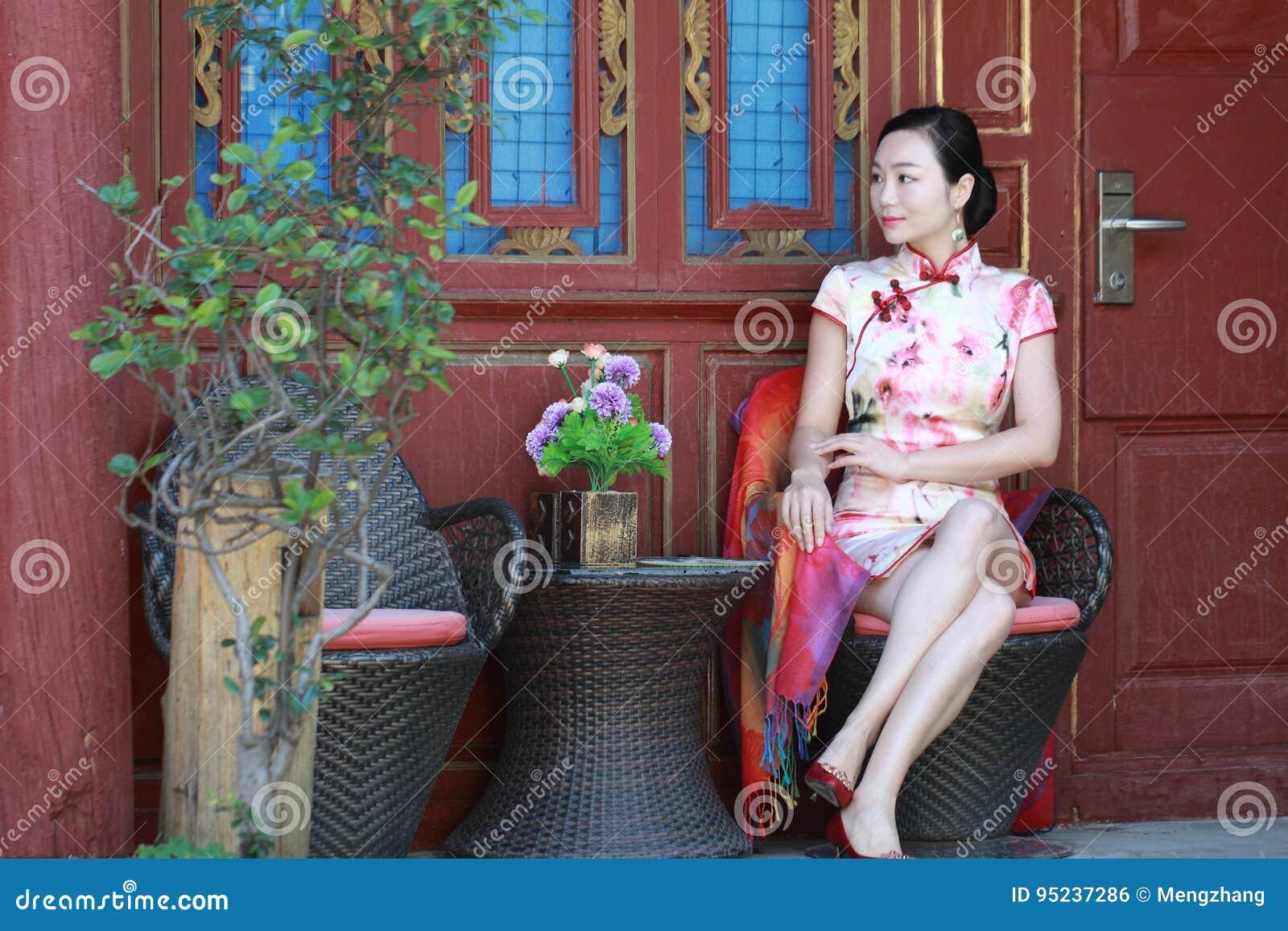 Asian Chinese girls wears cheongsam enjoy holiday in lijiang ancient town