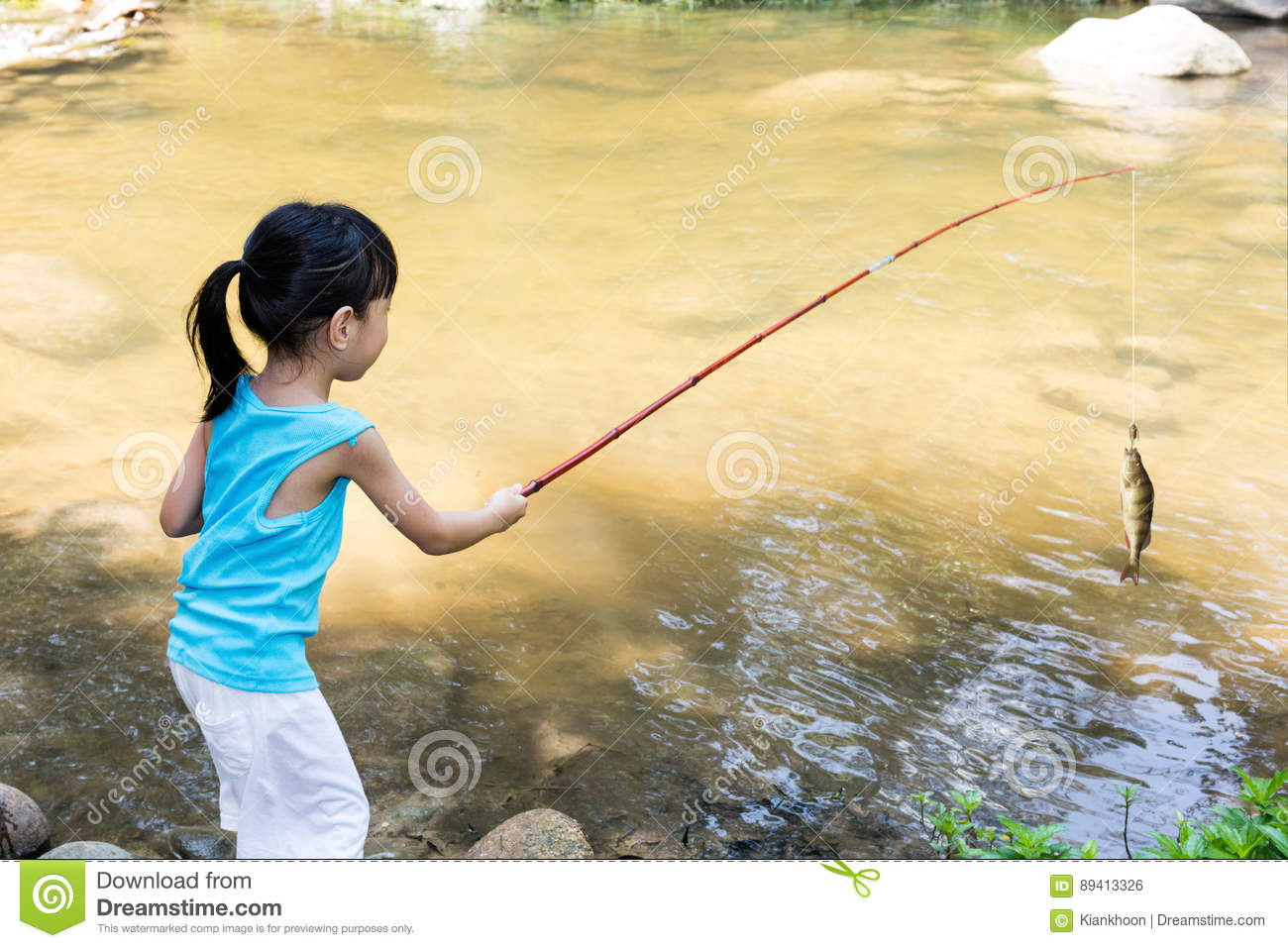 Asian Chinese little girl angling with fishing rod