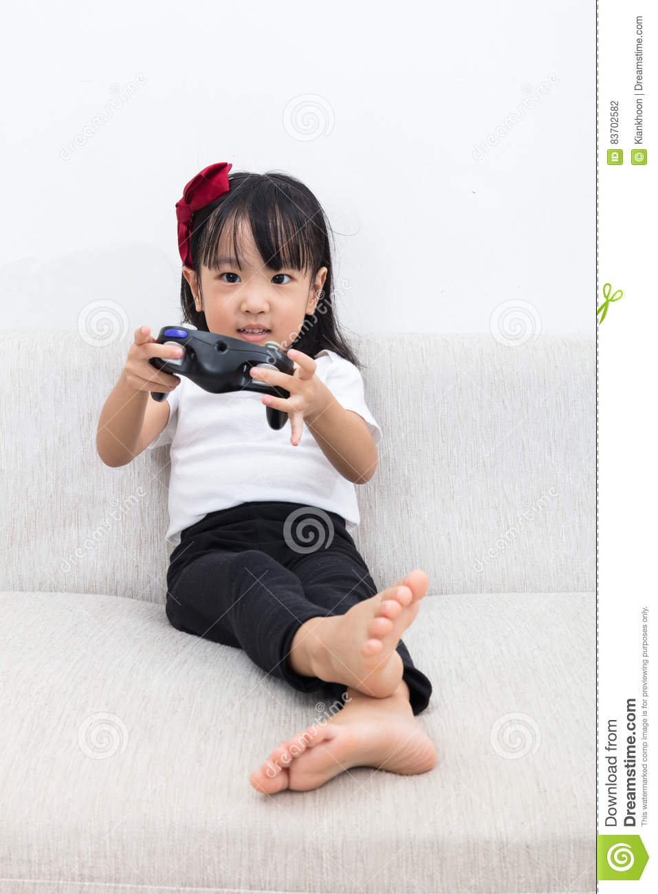 little girl playing video games on the joystick royalty free stock photo. Black Bedroom Furniture Sets. Home Design Ideas