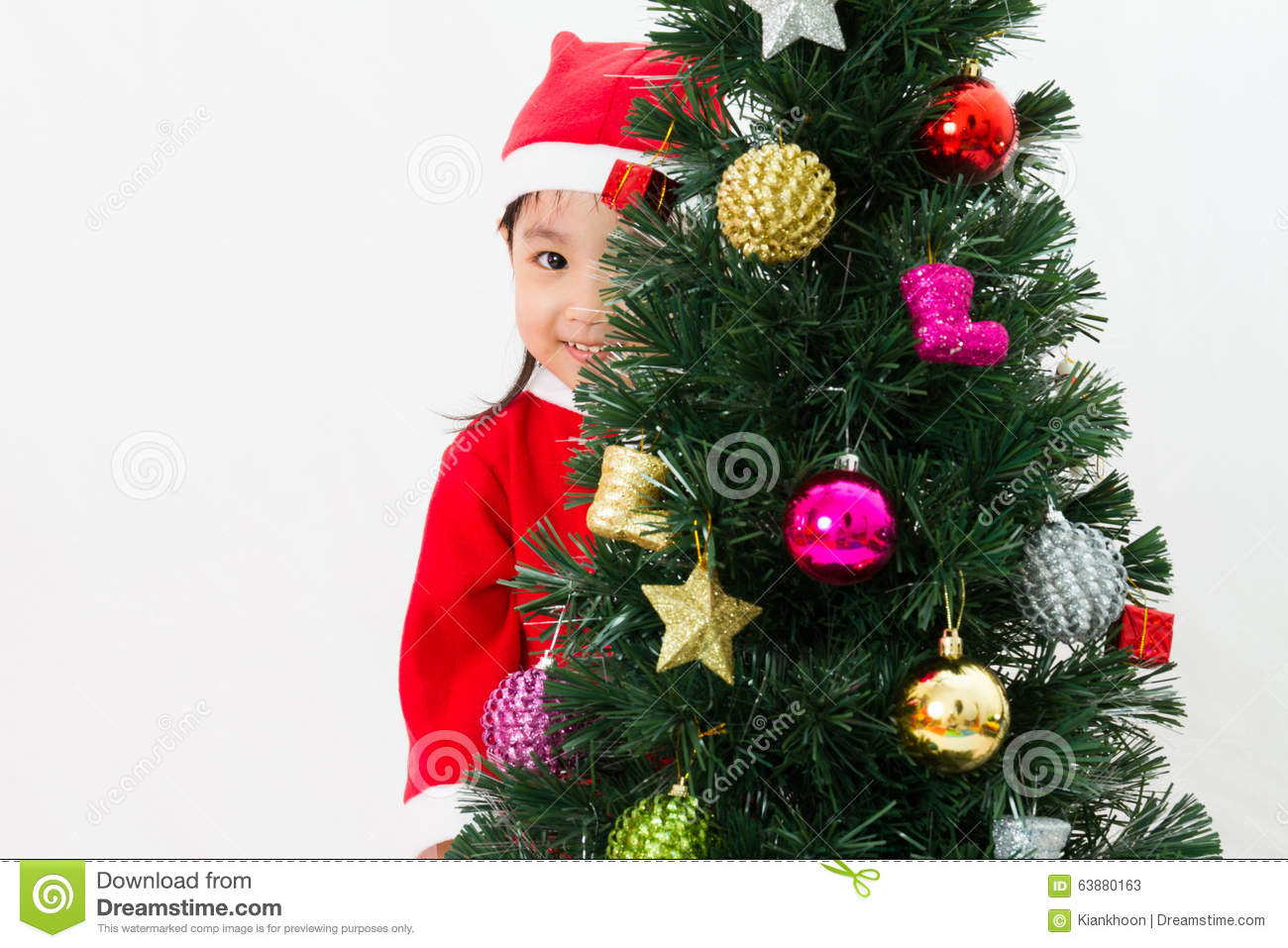 Asian Chinese Little Girl Posing With Christmas Tree Stock