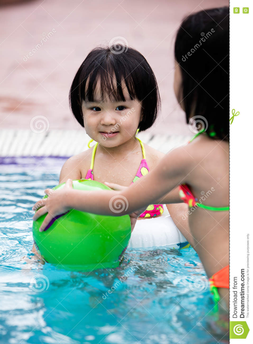 Asian Chinese Little Girls Playing In The Swimming Pool ...