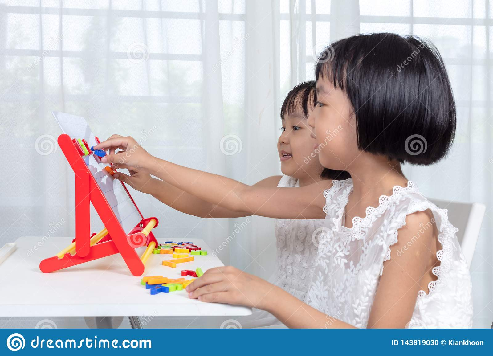 Asian Chinese little girls playing toys