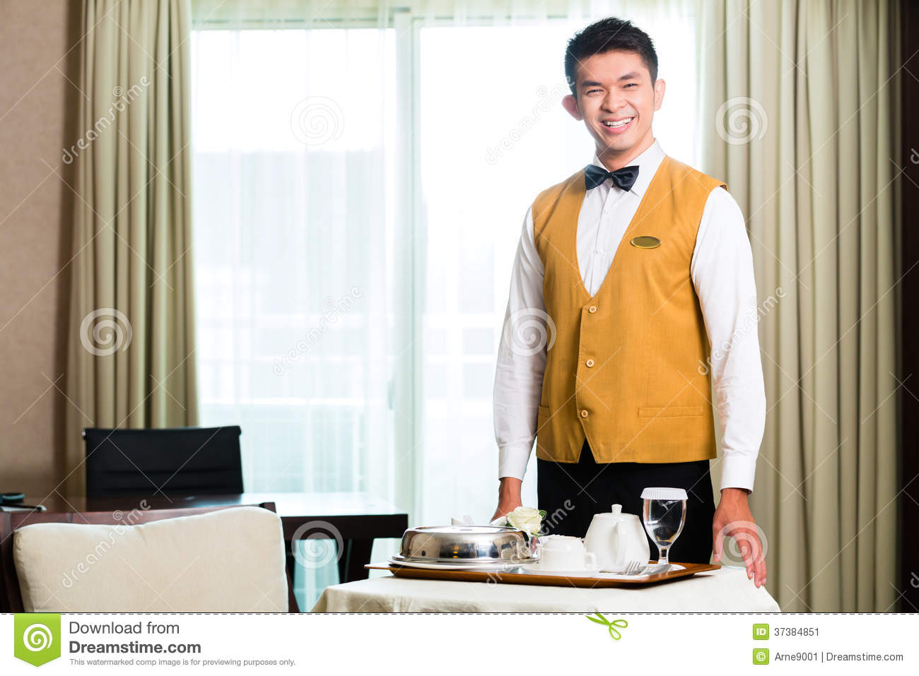 Room Service: Asian Chinese Room Service Waiter Serving Food In Hotel