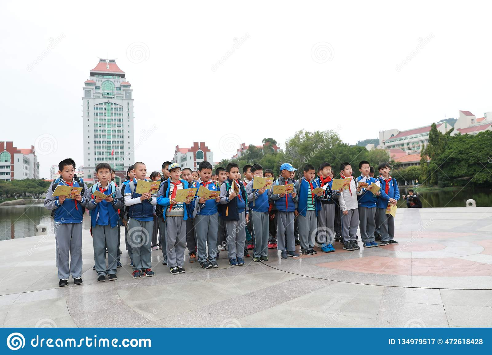 Asian chinese students reading a book. Nine, focus