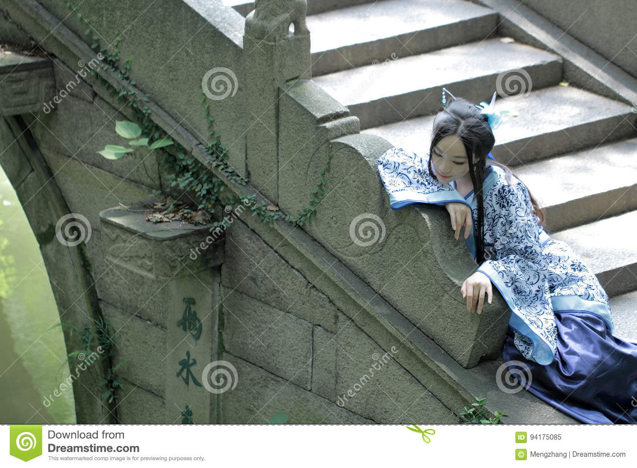 Asian Chinese woman in traditional Blue and white Hanfu dress, play in a famous garden