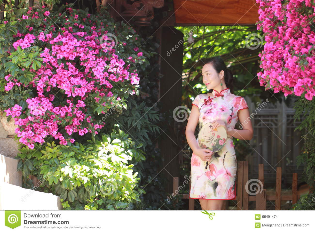 Asian Chinese woman in traditional cheongsam enjoy free time at lijiang