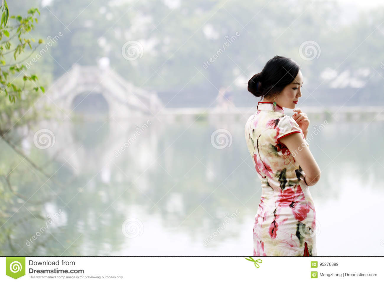 Asian Chinese woman in traditional cheongsam