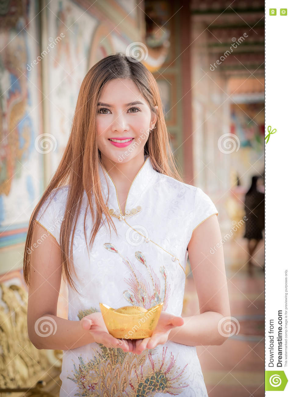 The Asian Chinese woman in Traditional Chinese hold Chinese mon