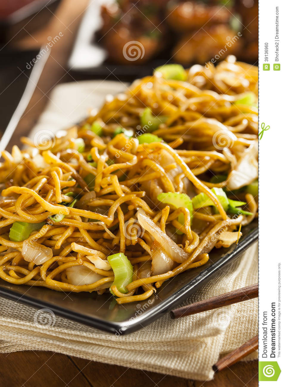 Asian Chow Mein Noodles with Vegetables and Chopsticks.
