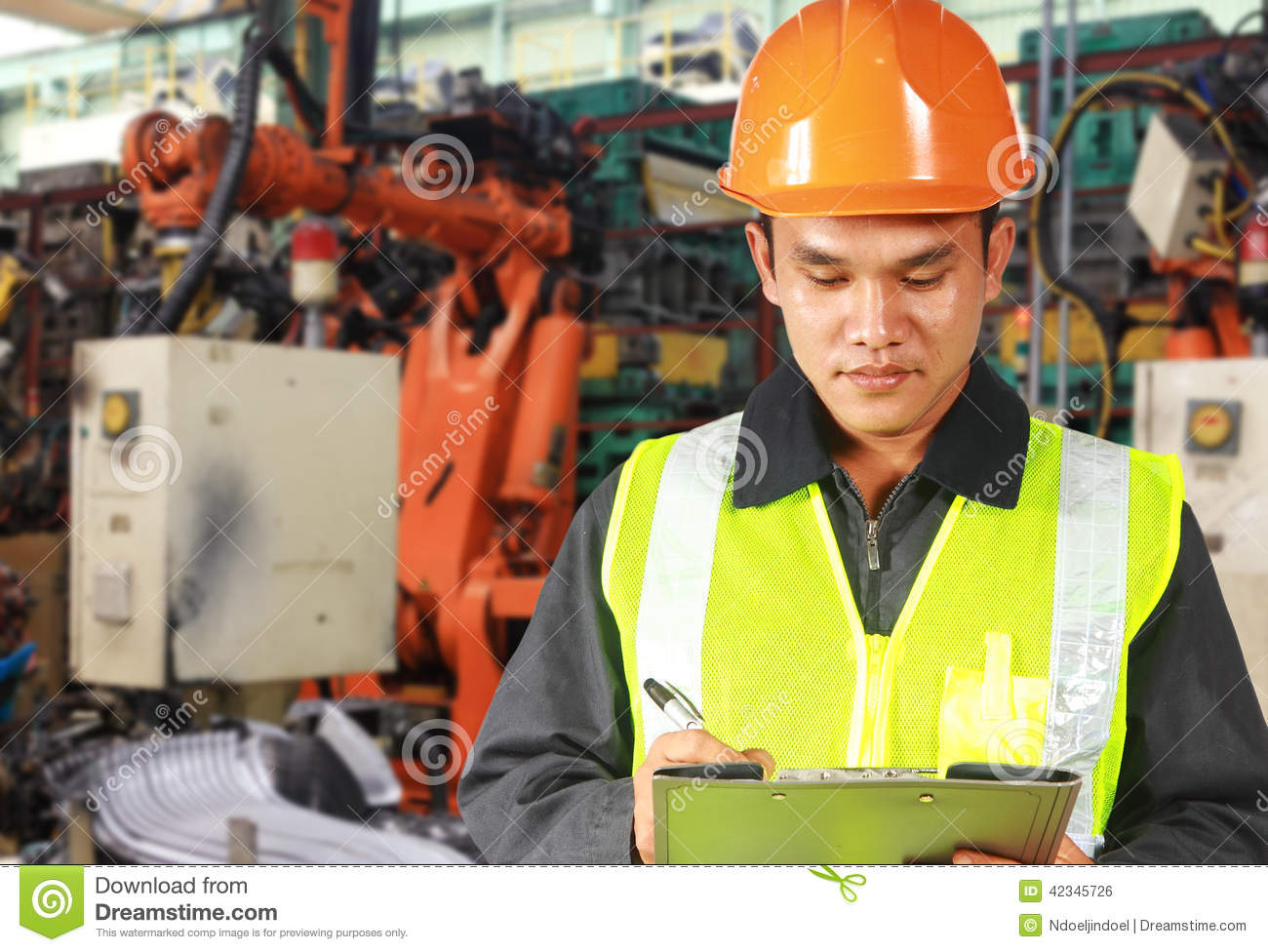 Civil Engineers At Work : Engineer robot wearing safety helmet stock photo