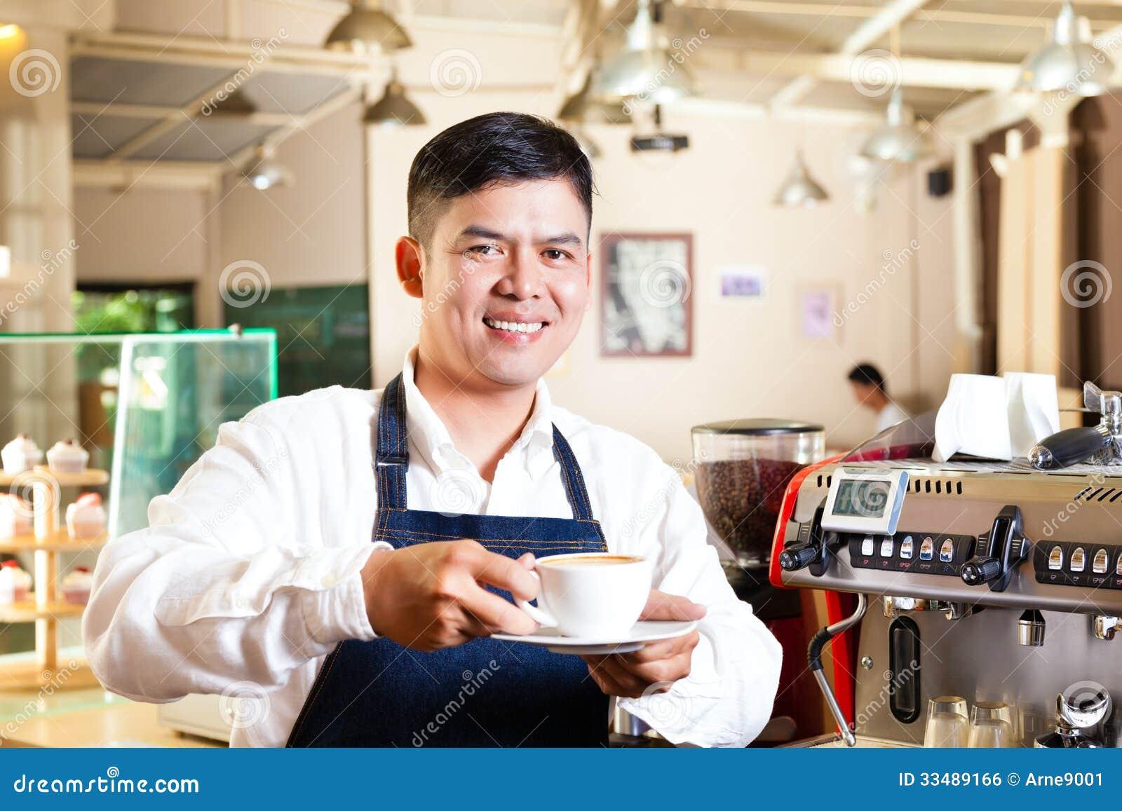 Asian Coffeeshop Barista Presents Coffee Royalty Free