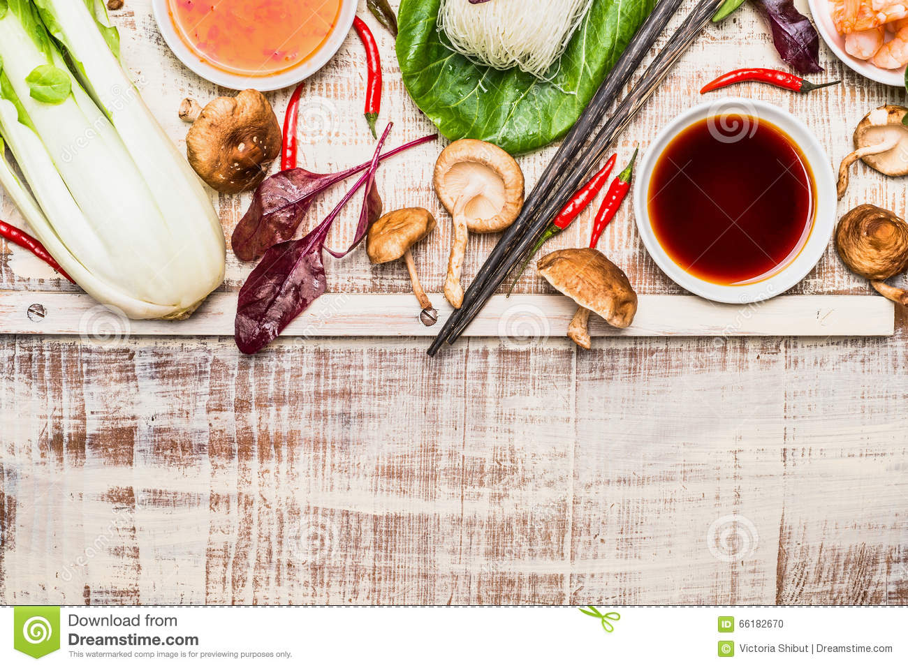 Asian cooking ingredients with chopsticks on rustic wooden for Asian cuisine ingredients