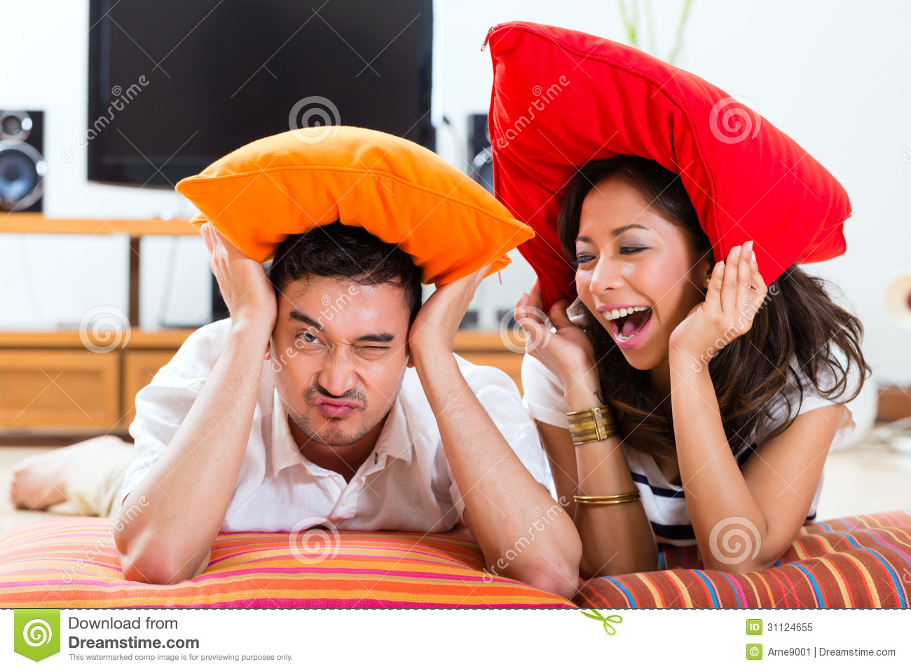 Asian Couple At Home In Their Living Room Royalty Free