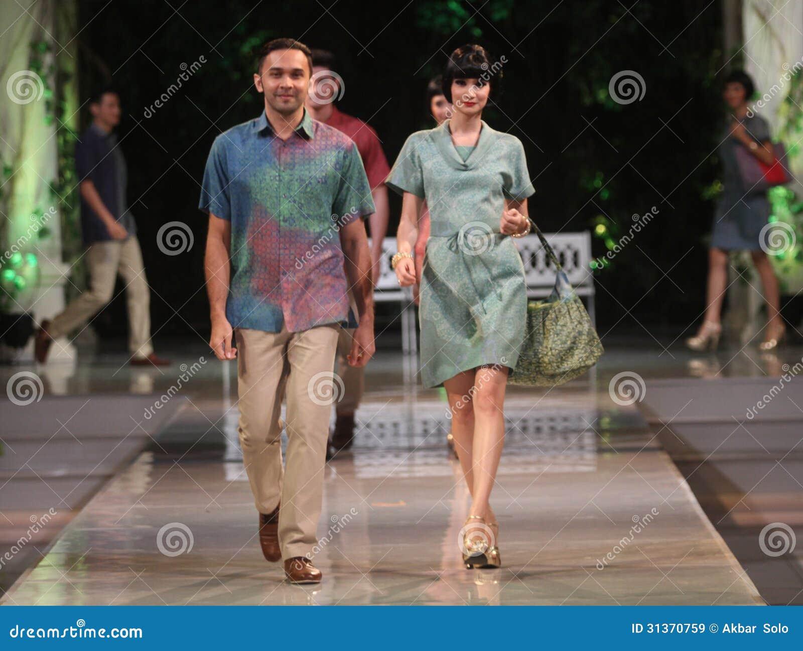 Asian couple model wearing indonesian traditional batik at batik keris ...