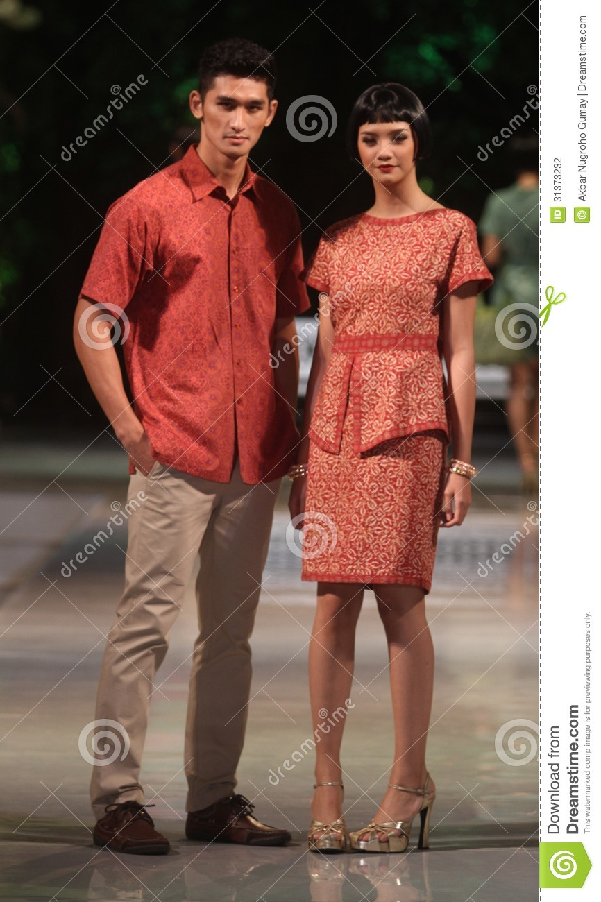 Asian couple model wearing indonesian traditional batik at batik keris ...