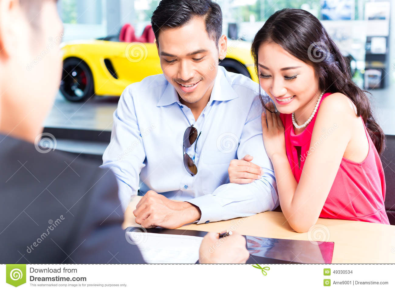 asian couple signing sales contract for car stock photo image of